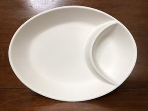a white plate on a table