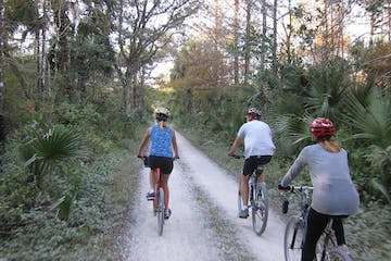 people riding bikes through big cypress institute