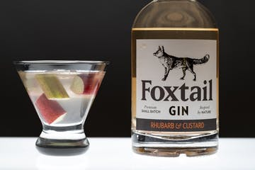 a bottle and a glass of Foxtail gin
