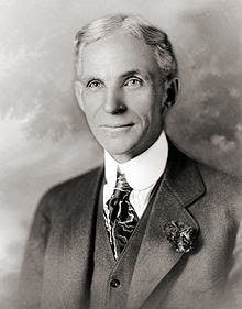 Henry Ford wearing a suit and tie