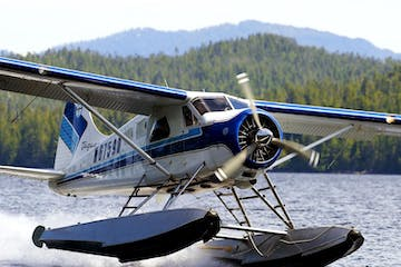 a small plane sitting on top of a body of water