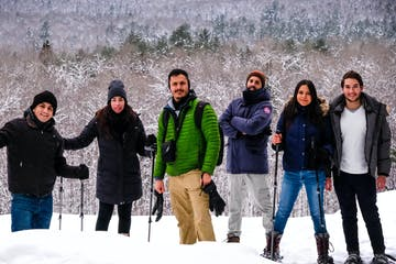 a group of people posing for a picture in the snow