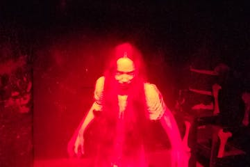 a person in a red lit up at night