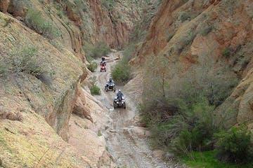 People riding on ATVs through Box Canyon in Arizona