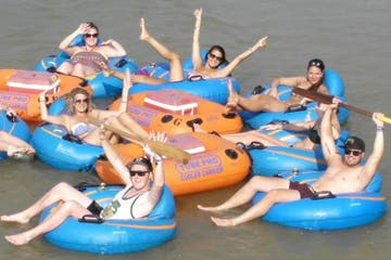 a group of people in blue water