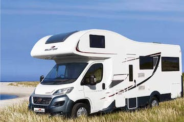 a motorhome parked on the grass in scotland