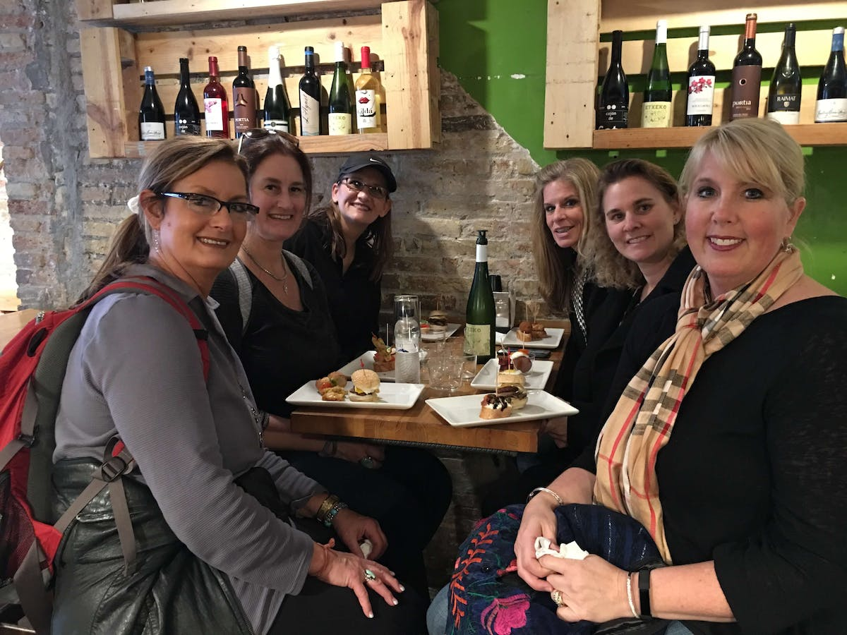 Group of clients tastings and enjoying a food and wine tour in Barcelona | Uncorked Vines