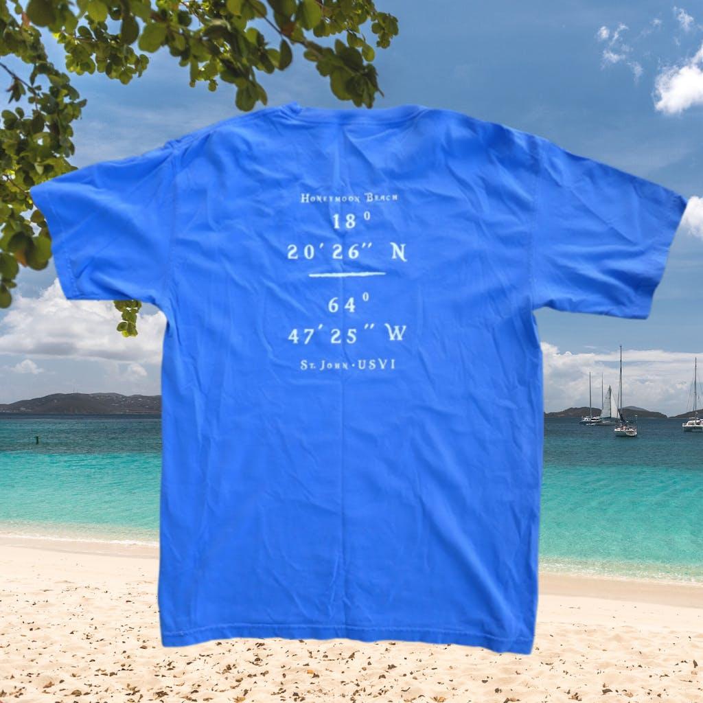a blue umbrella on the beach