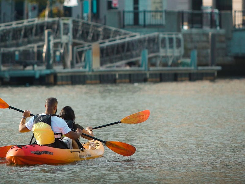 Two people paddling on a tandem kayak in Providence, RI
