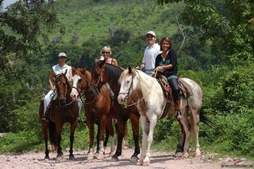 a group of people riding on the back of horses