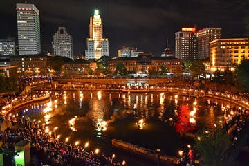 a view of WaterFire at night