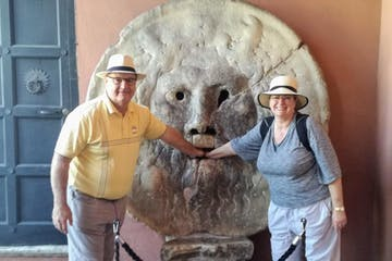 a couple with the hands inside the mouth of Truth in Rome