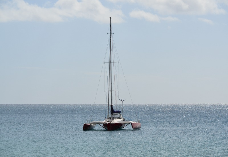 a small boat in a large body of water