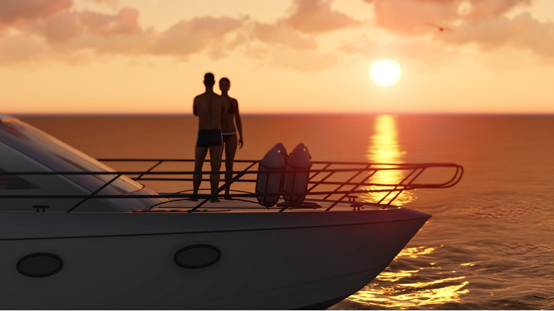 a sunset behind a boat on the beach