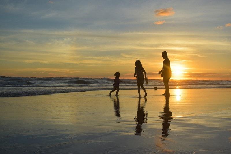 a family on the beach near the sea