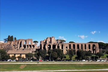 a large building with Circus Maximus in the background