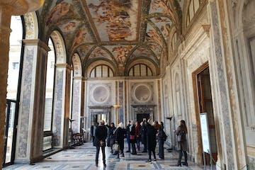 tour group standing under villa farnesina