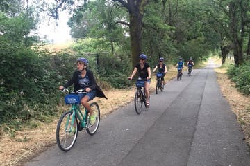 people riding bikes on a trail