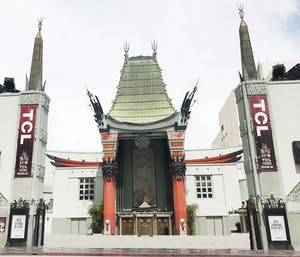 a group of people walking in front of Grauman's Chinese Theatre