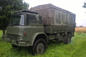 a green truck parked in a field