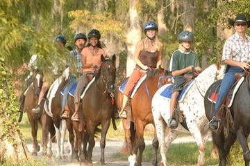 a group of people riding horses