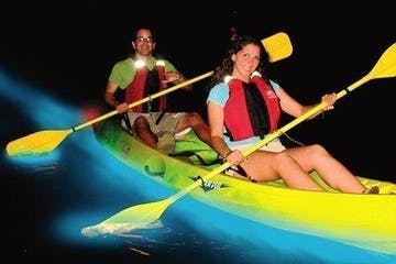 people in a yellow kayak