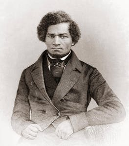 Frederick Douglass wearing a suit and tie