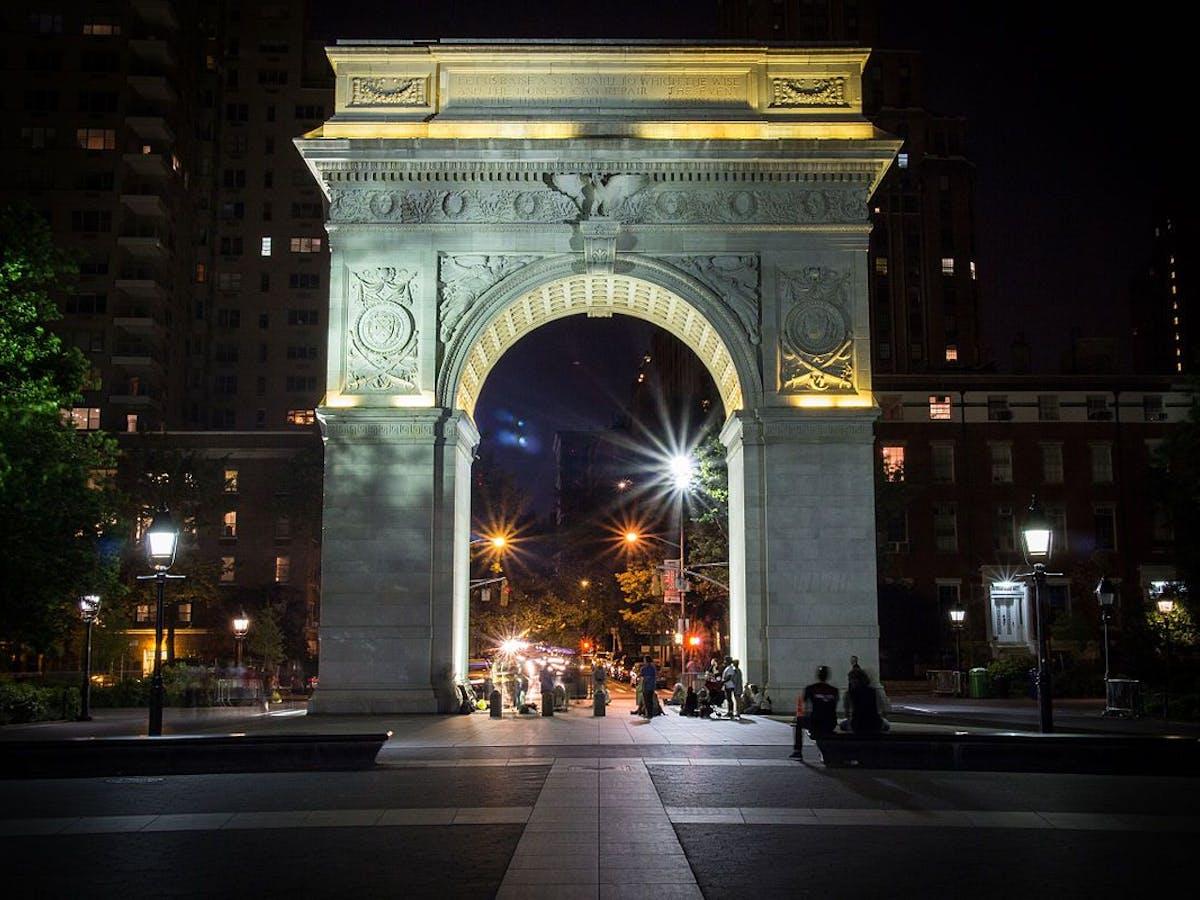 a view of Washington Square Park at night