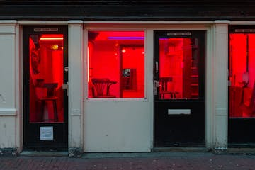 a store front with a red door
