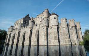 a castle on top of a stone building with Gravensteen in the background