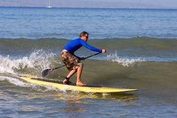 a young man riding a wave on a surfboard in the ocean