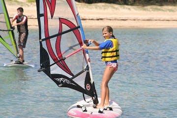 kid windsurfing