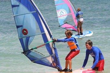 kid learning to windsurf