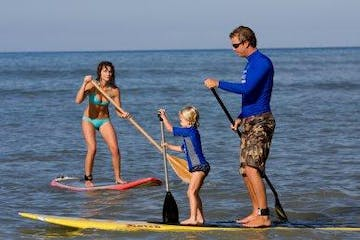 kid learning to sup