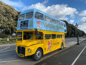 a double decker bus parked on the side of a road