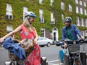 a person riding a bike on a city street
