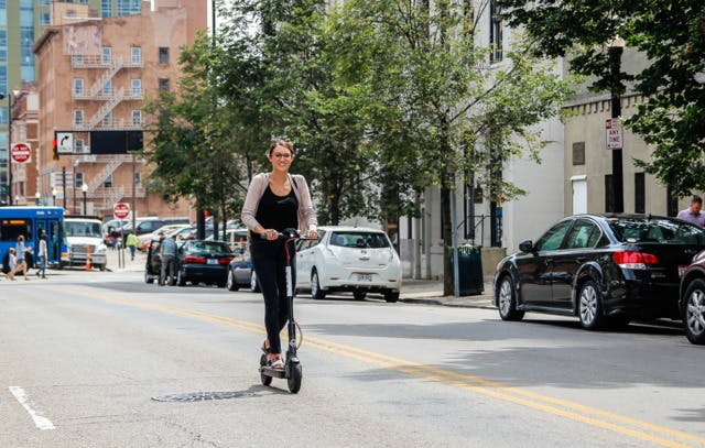 a person riding an electric scooter