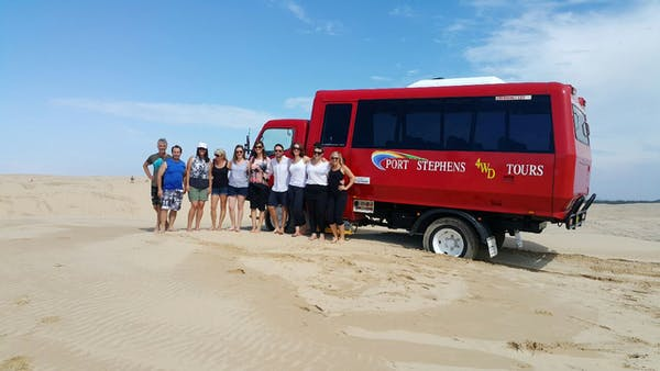 a large red truck on a beach