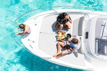 A family enjoying a fruit platter on Cap Camarat boat in Bora Bora