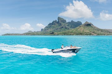A couple enjoying a private boat tour in Bora Bora