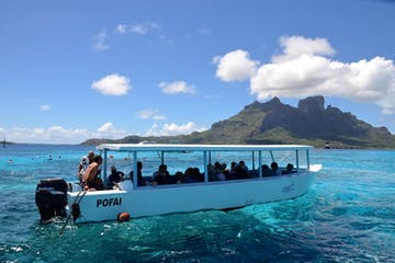 A group of people in a glass bottom boat in Bora Bora