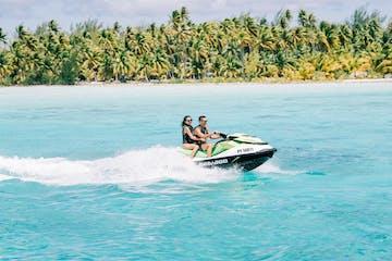 A couple jet skiing in Bora Bora