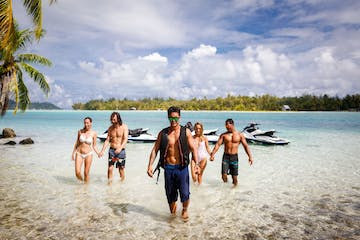 A group of people having a break during a jet ski tour in Bora Bora