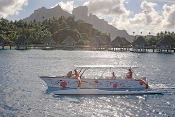 A Polynesian outrigger sailing in Bora Bora