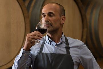 a man drinking wine