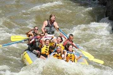 A group of people whitewater rafting Park City, Utah