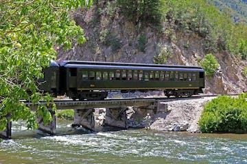 a train is traveling down the river