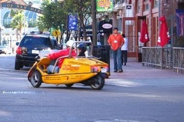 a person riding a motorcycle on a city street