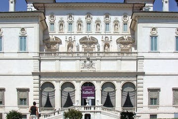a large stone building with many windows with Galleria Borghese in the background