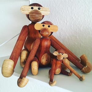 a group of stuffed animals sitting on top of a wooden table